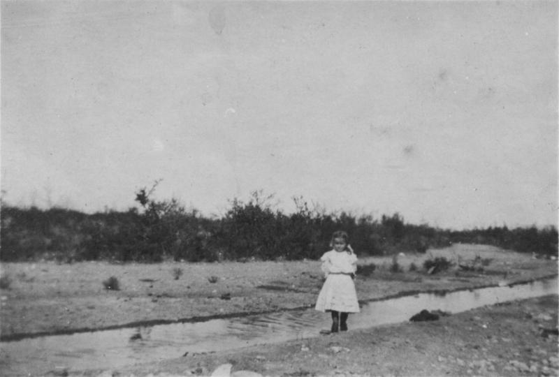 Completed diversion ditch. Cora Splittgarber standing beside it, about 1910.